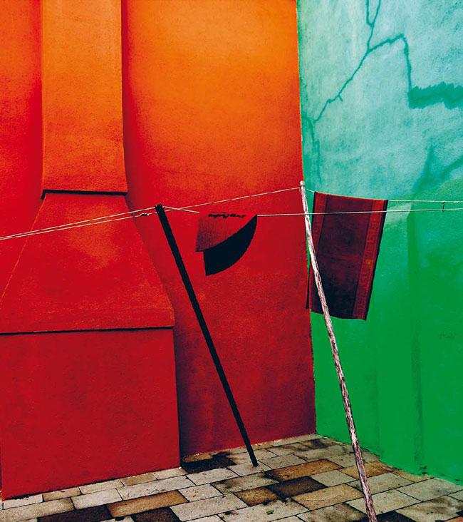 Farbige Häuserwände auf Burano - orange, grün und türkis